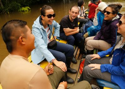 Group-of-tourists-sailing-the-Amazon-river-happy