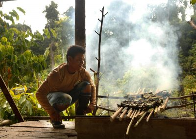 Indigenous-people-grilling-fish-wrapped-in-banana-leaves-in-the-Amazon
