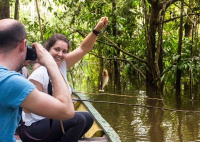 Tourist-taking-pictures-while-fishing-amazons