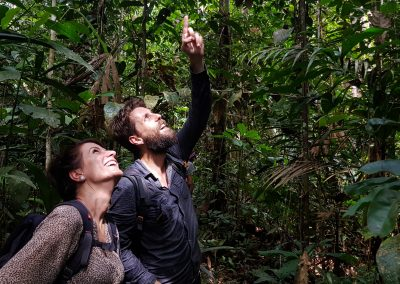 Tourists-exploring-the-Amazon-jungle-in-search-of-birds-1