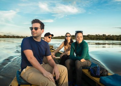 Tourists-in-canoe-by-the-amazon-river