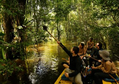 tourist-navigating-the-flooded-jungle-of-the-Amazon-1