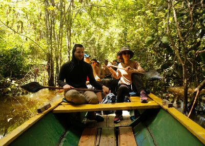 tourist-navigating-the-flooded-jungle-of-the-Amazon