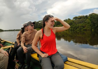 tourist-sailing-the-amazon-river-happy-for-pink-dolphins
